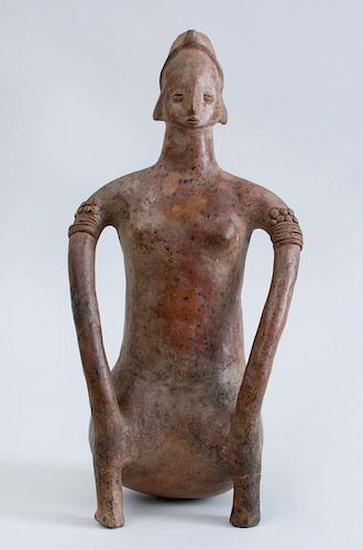 NAYARIT PROTOCLASSICAL POTTERY FIGURE OF A SEATED FEMALE