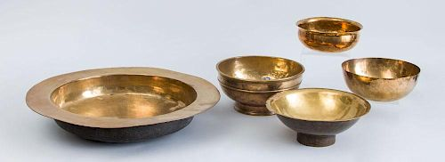 CONTINENTAL BRASS BROAD-RIMMED BASIN AND FOUR OTHER BRASS BOWLS