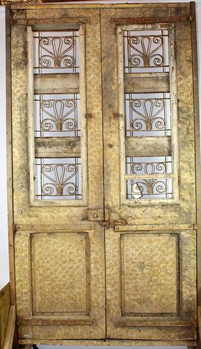 Pair weathered & carved entry doors with iron panels