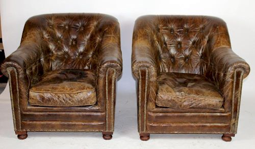 Pair of tufted leather armchairs