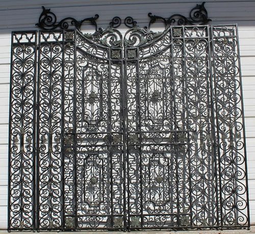 Scrolled iron gate set with bronze accents.