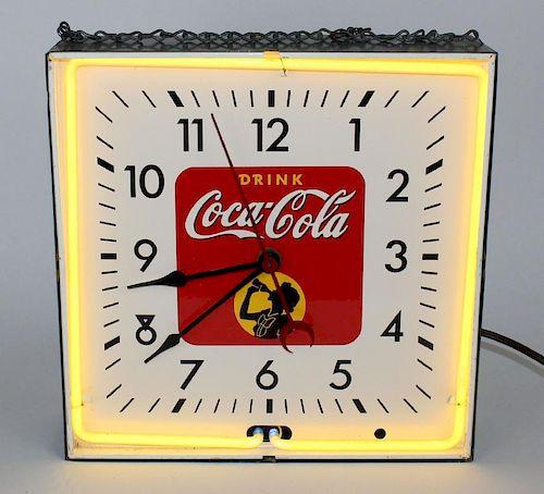 Vintage Coca-Cola neon clock in metal case
