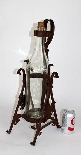 Spanish wine bottle in wrought iron holder