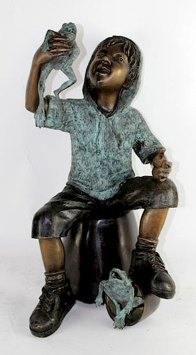 Bronze fountain of boy with frogs