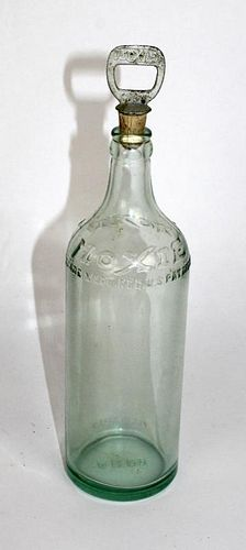 Vintage Moxie bottle with stopper