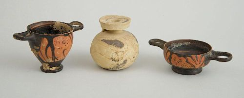 TWO APULIAN RED-OWL FIGURES, A SMALL TWO-HANDLED VESSEL, AND AN ATTIC BUFF-GROUND SPHERICAL JAR