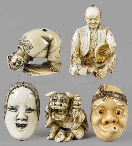 Five Japanese Meiji period carved ivory netsukes, to include two masks and three figures with mask