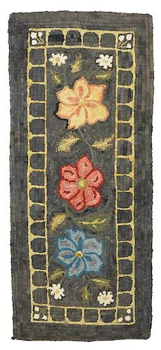 Floral hooked rug or table cover, early 20th c., 16'' x 36''.