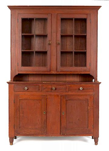 Pennsylvania painted poplar Dutch cupboard, ca. 1835, retaining its original red stained surface,