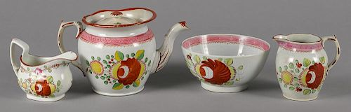 Queen's Rose pearlware teapot, 19th c., 5 1/2'' h., together with a waste bowl and two creamers.