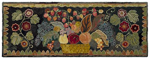 American hooked rug, ca. 1900, with an elaborate basket of fruit flanked by floral sprigs, 25 1/2''