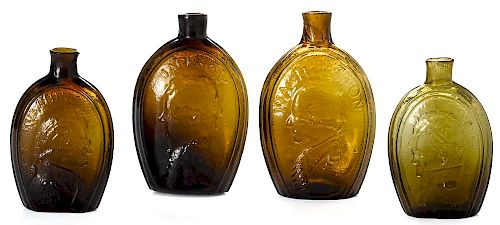 Four Historical amber and olive glass Washington and Jackson portrait flasks, tallest - 7''.