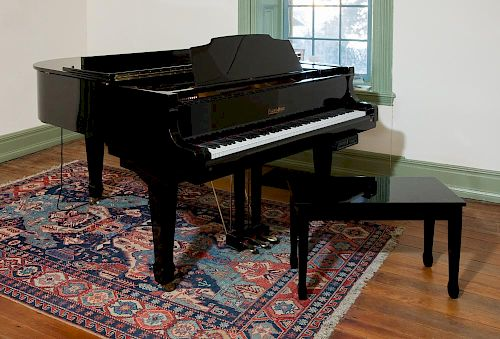 Young Chang baby grand piano with piano disc player and stool.