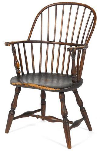 New England sackback Windsor armchair, ca. 1790, retaining an old dark varnished surface. Provenan