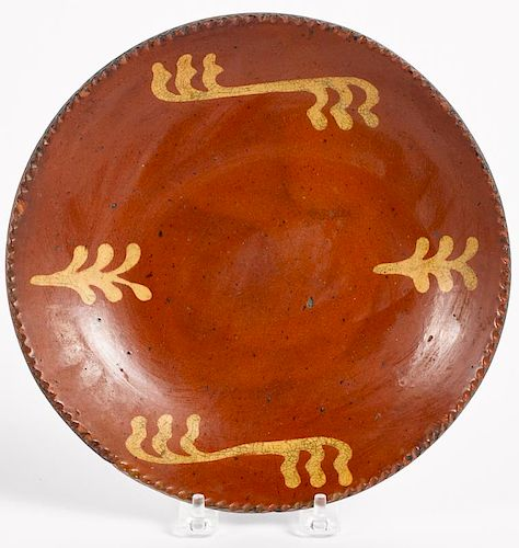 Pennsylvania redware plate, 19th c., with yellow slip decoration, 9 1/4'' dia.