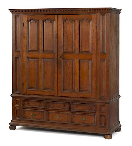 Pennsylvania or New York cherry schrank, late 18th c., with dentil cornice and raised panel doors,