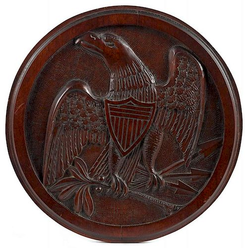Carved mahogany plaque, early 20th c., with an American eagle, 13 5/8'' dia. Provenance: New Jersey