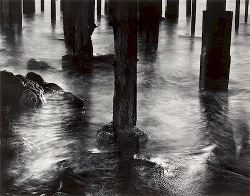 Wynn Bullock, (American, 1902-1975), Pilings under Cannery Row, 1958