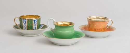 Three Porcelain Teacups and Saucers