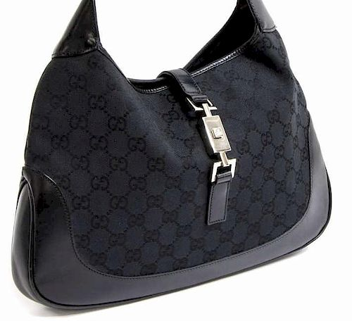 5b3437e3f66d GUCCI JACKIE BLACK MONOGRAM CANVAS SHOULDER BAG. Lot 352. Prev Lot · Next  Lot · item Image