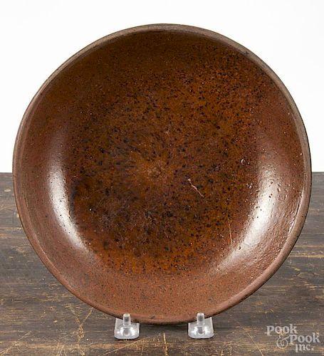 Pennsylvania redware plate, 19th c., with manganese splotching, 9'' dia.