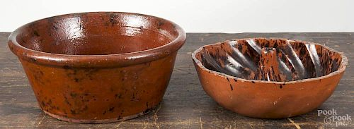 Pennsylvania redware bowl, 19th c., with manganese splotching, 4 1/2'' h., 10 1/2'' dia., together wit