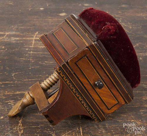 Inlaid mahogany pin cushion sewing clamp, 19th c., with a drawer over a Greek key border, 6'' h.