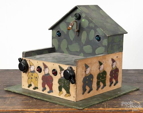 Painted pine battery operated stage, 20th c., with clowns, 10 1/2'' h., 12 1/2'' w.