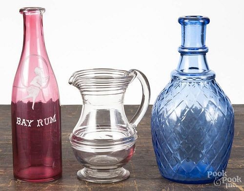 Three pieces of glass, to include Bay Rum bottle, 9'' h., a contemporary cobalt diamond pattern decan