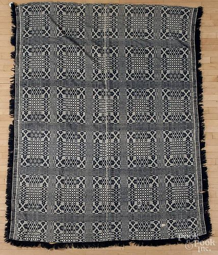 Blue and white overshot coverlet, mid 19th c., 96'' x 78''.
