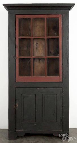 Bryce Ritter contemporary painted pine cupboard, dated 2002, with a red and black surface, 82 3/4''
