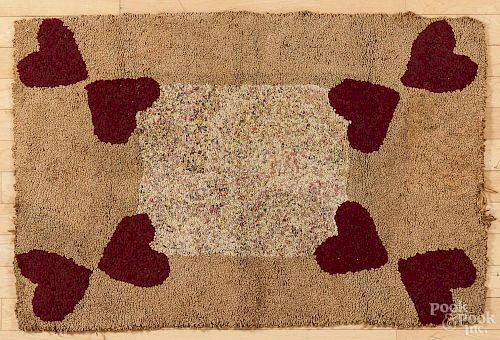 Hooked rug with heart corners, early 20th c., 38'' x 25 1/2''.