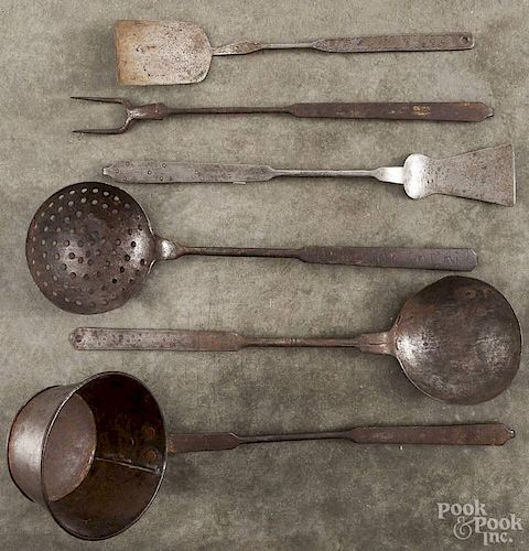 Six wrought iron utensils, 19th c., with punch decorated handles, longest - 19'' l.