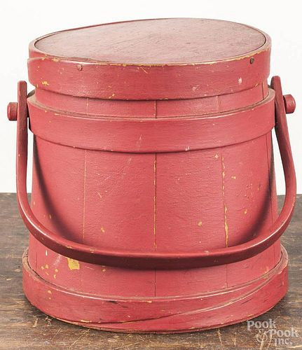 Painted pine firkin, ca. 1900, retaining a later red over a mustard surface, 9 1/2'' h.