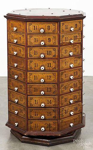 Stenciled pine revolving parts cabinet, ca. 1900, 32'' h., 21'' w.