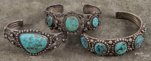 Three Navajo silver and turquoise bracelets.