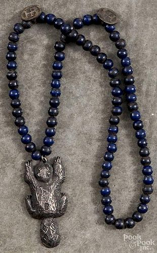 Native American Indian beaver amulet on a beaded necklace, stamped Mont?, 2 3/4'' l.