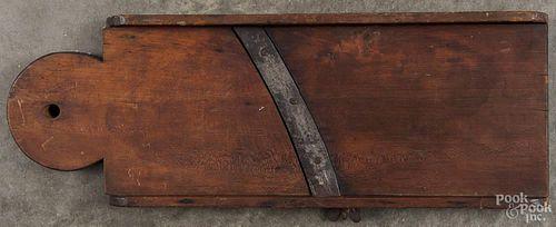Pennsylvania cherry slaw board, 19th c., with a lollipop end, 24'' h.