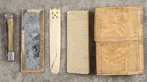 Leather book-form etuis, 19th c., 3 1/4'' h.