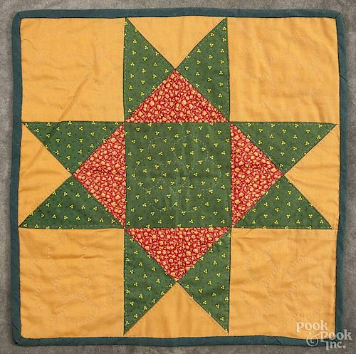 Pennsylvania patchwork star variant doll quilt, 20th c., 15'' square.