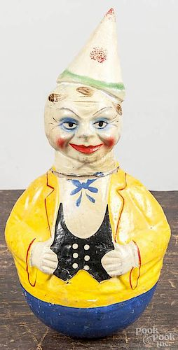 Two composition clown roly poly toys, ca. 1930, 12 1/2'' h. and 10'' h.