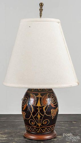 Greg Shooner redware table lamp, signed and dated 2002, with slip tulip decoration, 10 1/2'' h.