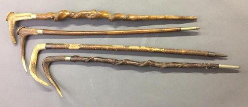 Four Similar Stag Handled Walking Sticks