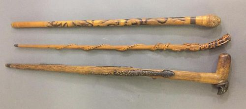 Three Carved Snake Canes