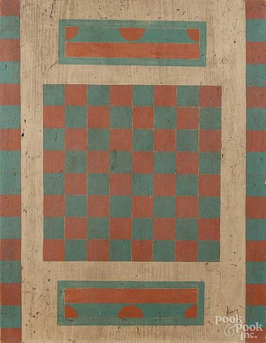 Painted pine gameboard, 19th c., with a later blue, cream, and salmon surface, 23 1/2'' x 18''.