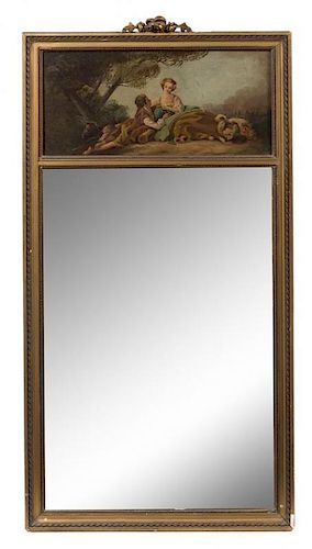 * A French Painted and Parcel Gilt Trumeau Mirror Height 58 x width 29 inches.