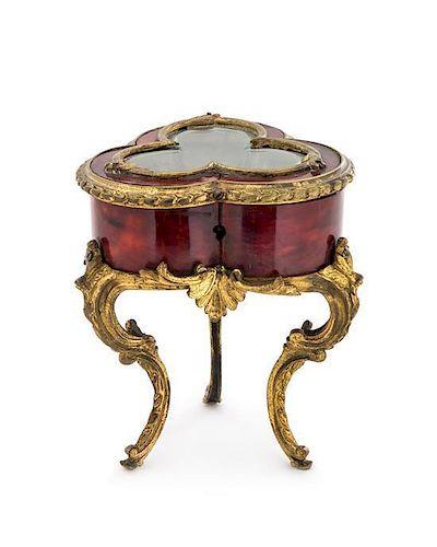 A Louis XV Style Gilt Bronze Mounted Tortoiseshell Diminutive Table Vitrine Height 6 1/4 inches.