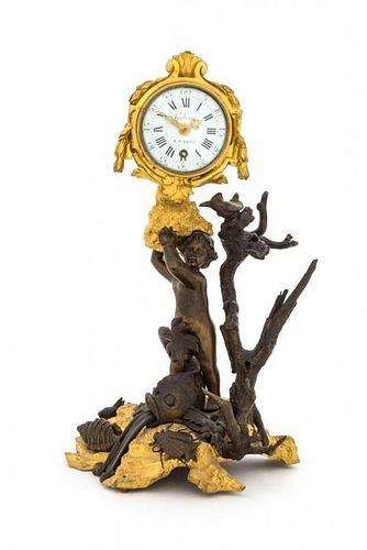 A French Gilt and Patinated Bronze Figural Clock Height 11 1/8 inches.