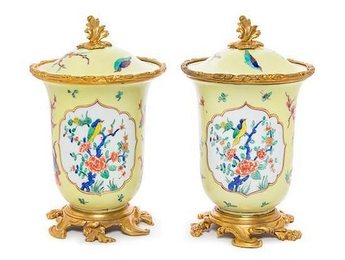 * A Pair of French Gilt Bronze Mounted Porcelain Covered Jars Height 8 inches.