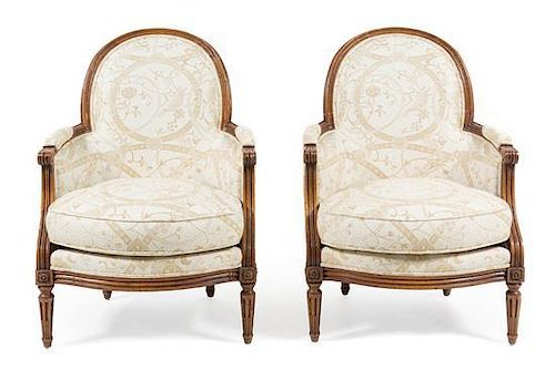 A Pair of Louis XVI Style Oak Bergeres Height 36 1/2 inches.
